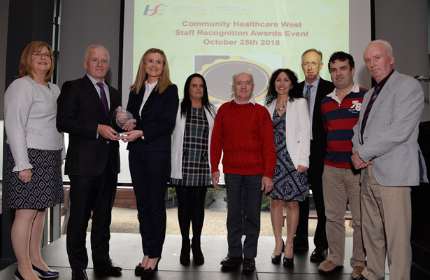 Overall Winner Innovative Project: Heartsaver CPR AED Training for Family Carers Tony Canavan, Chief Officer presenting the award to Michelle Harrison, Co-ordinator, Carers Department, Social Care and the team.